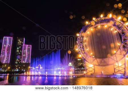 Astana, Kazakhstan - August 28, 2016: Musical fountain show in Ishim river. Fountain is 180 meters high and symbolizes the sun. Water screen situated inside the fountain circle.