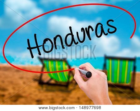 Man Hand Writing Honduras With Black Marker On Visual Screen