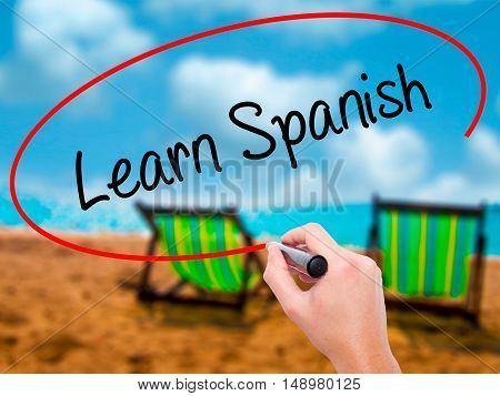 Man Hand Writing Learn Spanish With Black Marker On Visual Screen