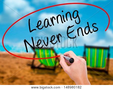 Man Hand Writing Learning Never Ends With Black Marker On Visual Screen