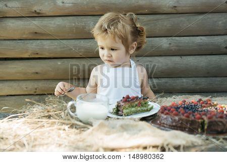 Little Boy Eats Fruit Cake