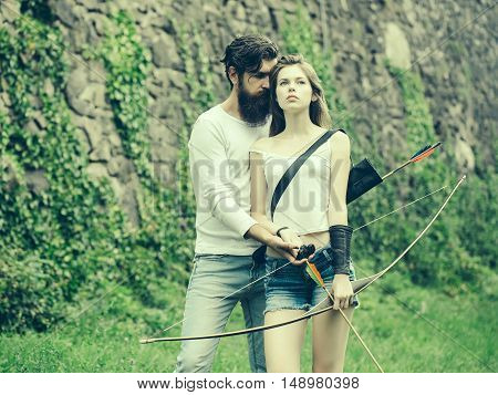 Couple Is Ready To Shoot From The Bow