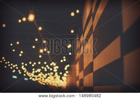 Empty Wall On Street Market Festival With Bokeh Lights In Front Of It - Selectively Shallow Focus