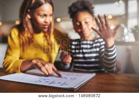 School homework concept mother and daughter calculating