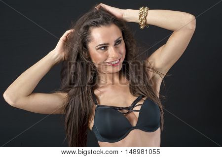 young beautiful pretty girl posing with underwear in the studio