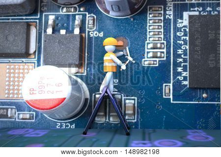 Puppet Working On A Big Motherboard Of Pc
