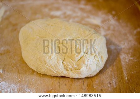 on the table fresh dough ready to bake