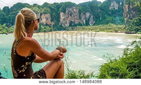 Blond beautiful Women on View Point to Hat Tom Sai Beach at Railay, Krabi, Thailand.