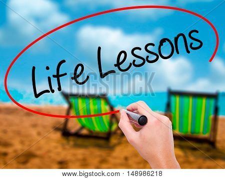 Man Hand Writing Life Lessons With Black Marker On Visual Screen