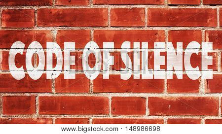 Code of silence Written On A Brick Wall.