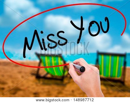 Man Hand Writing Miss You With Black Marker On Visual Screen
