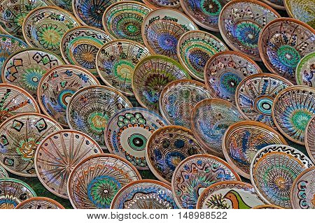 Background with Romanian traditional ceramic in the plates form painted with specific patterns from Horezu area.