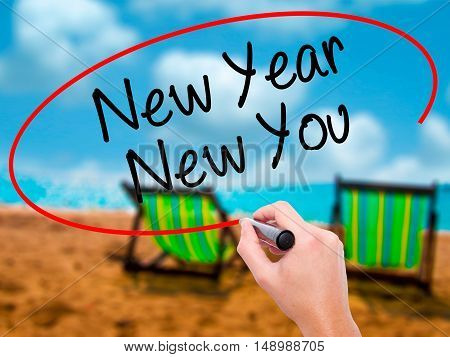 Man Hand Writing New Year New You With Black Marker On Visual Screen
