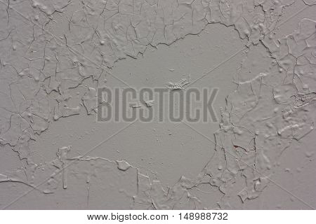 metal rusty surface painted in gray paint.cracked paint on a steel background