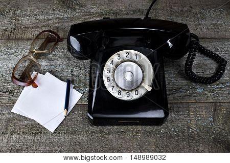 Vintage Black Phone And Old Glasses