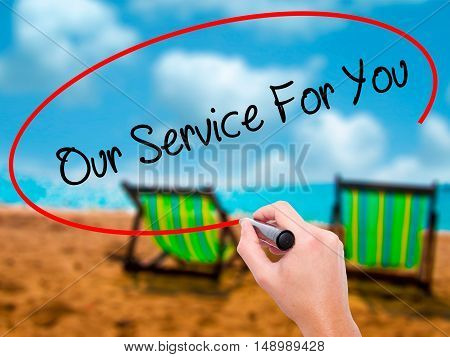Man Hand Writing Our Service For You With Black Marker On Visual Screen
