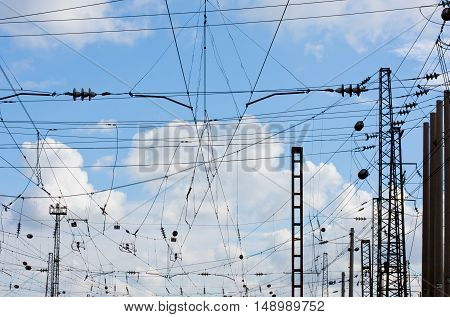 power line against the blue sky with white clouds at the railway station.Power Line against sky background.X-ray effect.