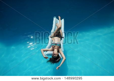 Young Woman Relaxing In Pool