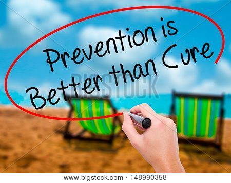 Man Hand Writing Prevention Is Better Than Cure With Black Marker On Visual Screen