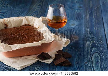 Fresh Black Brownies On A Blue Wood Background.