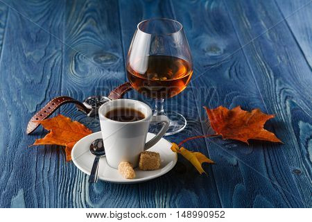 Close Up A Glass Of Cognac And Coffee
