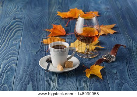 set of coffee and cognac with fall leaves