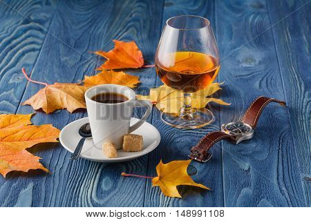 Goblets Of Brandy And Cup Of Hot Coffeeon Wooden Old Counter Top