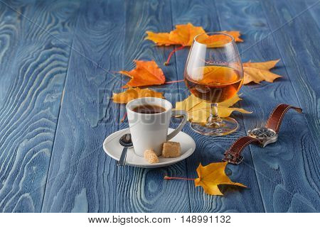 Autumn drinking time with alcohol glass and coffee