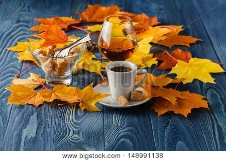 Autumn drinking time with alcohol glass and espresso