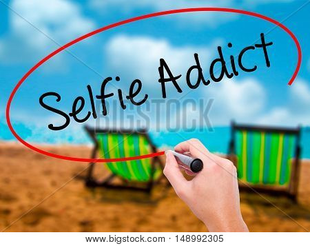 Man Hand Writing Selfie Addict With Black Marker On Visual Screen