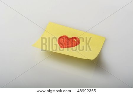paper notepad with a heart design that expresses the concept of love