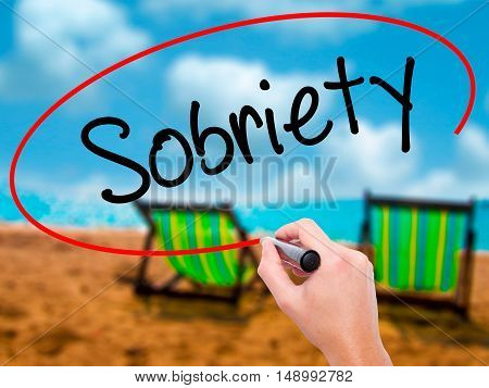 Man Hand Writing Sobriety With Black Marker On Visual Screen