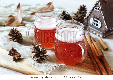 Two mugs of winter craft beer in New Year decorations