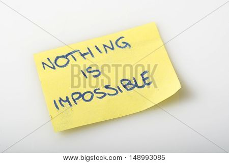 notepad with written nothing is impossible that expresses the concept that everything is doable