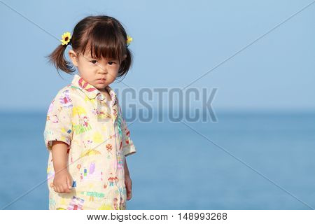 Japanese girl standing by the seaside (1 year old)