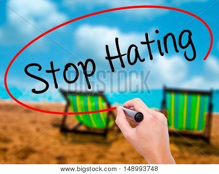 Man Hand Writing Stop Hating  With Black Marker On Visual Screen