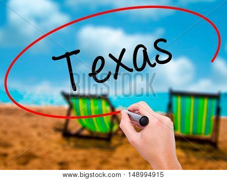 Man Hand Writing Texas  With Black Marker On Visual Screen
