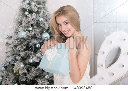 Portrait Of Beautiful Woman With Present Box In Christmas Time
