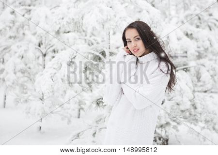 Portrait Of Pretty Brunette Wearing White Warm Sweater