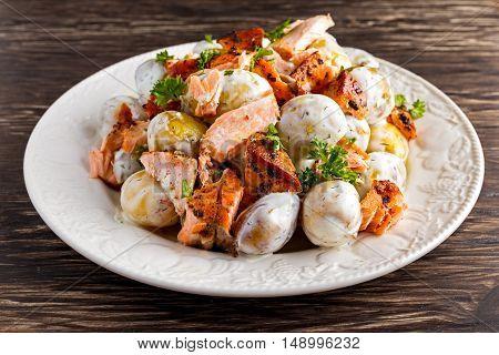 Salmon and young potato warm salad with a lemony yogurt dressing.
