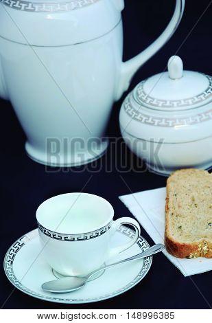 Breakfast set of porcelain engraved in silver.