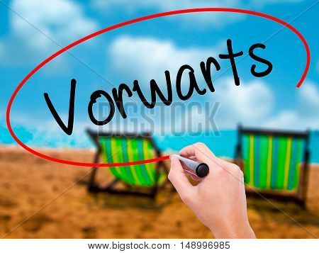 Man Hand Writing Vorwärts  (forward In German)  With Black Marker On Visual Screen