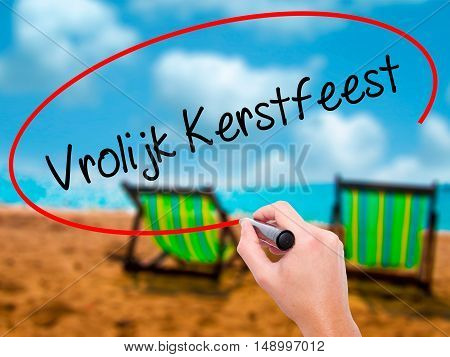 Man Hand Writing Vrolijk Kerstfeest  (happy Christmas In Dutch) With Black Marker On Visual Screen