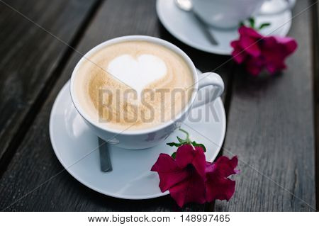 cup of coffee with heart decorated with flowers