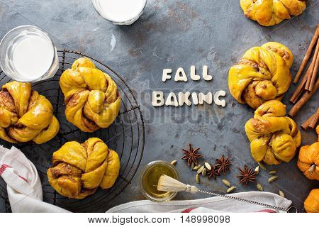 Fall baking concept homemade pumpkin cinnamon yeasted buns shot from above