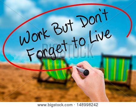 Man Hand Writing Work But Don't Forget To Live  With Black Marker On Visual Screen