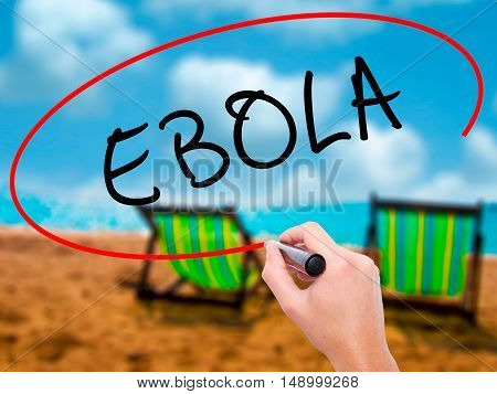 Man Hand Writing Ebola With Black Marker On Visual Screen