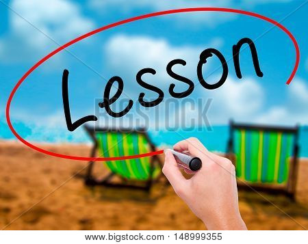 Man Hand Writing Lesson With Black Marker On Visual Screen