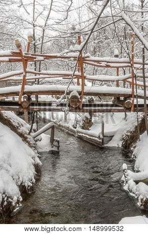 Wooden bridge in snow close-up. Karpaty Ukraine