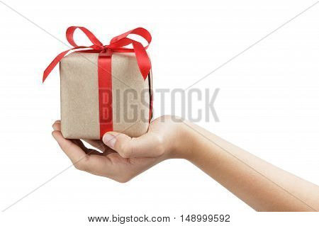 small gift box wraped in recycled paper with ribbon bow on female teen hand, isolated